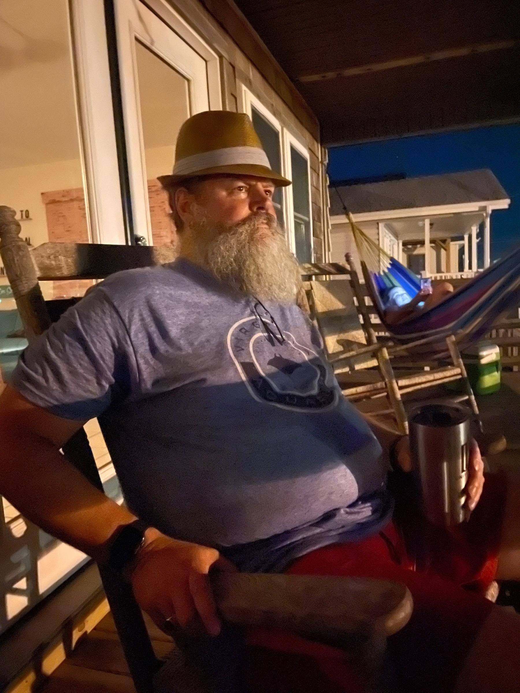 hat-wearing man at sunset